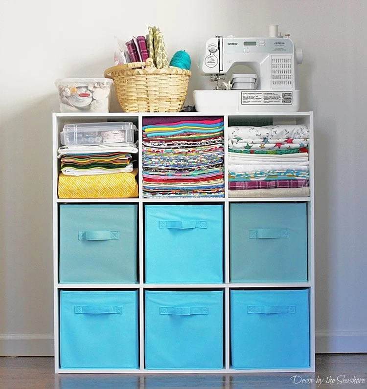 Organize a small craft space with cubbies and coordinating bins How to Store Craft Supplies in a Small Space via Decor by the Seashore Jenna Kate at Home