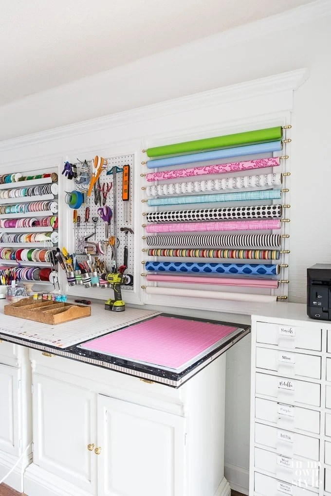 Utilize the walls when organizing your small craft room space. Create your own creative wall of storage!