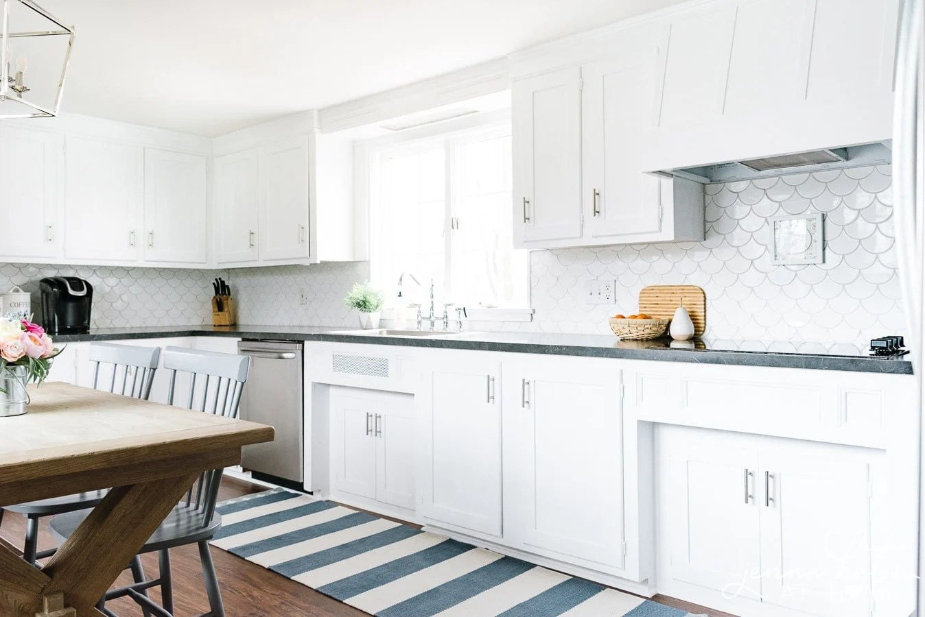 bright white kitchen cabinets with blue striped runner