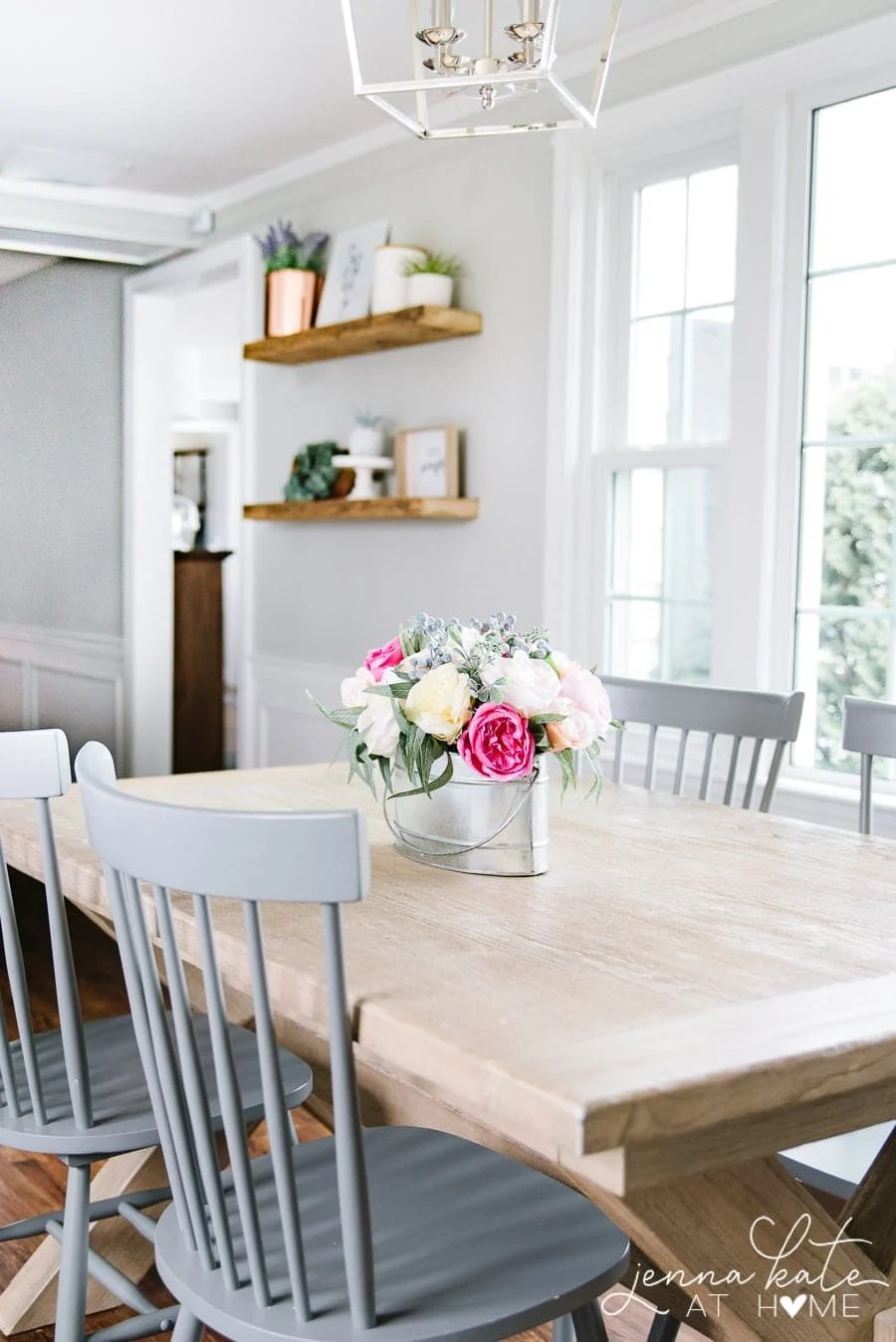 kitchen table with gray chairs and flower arrangement
