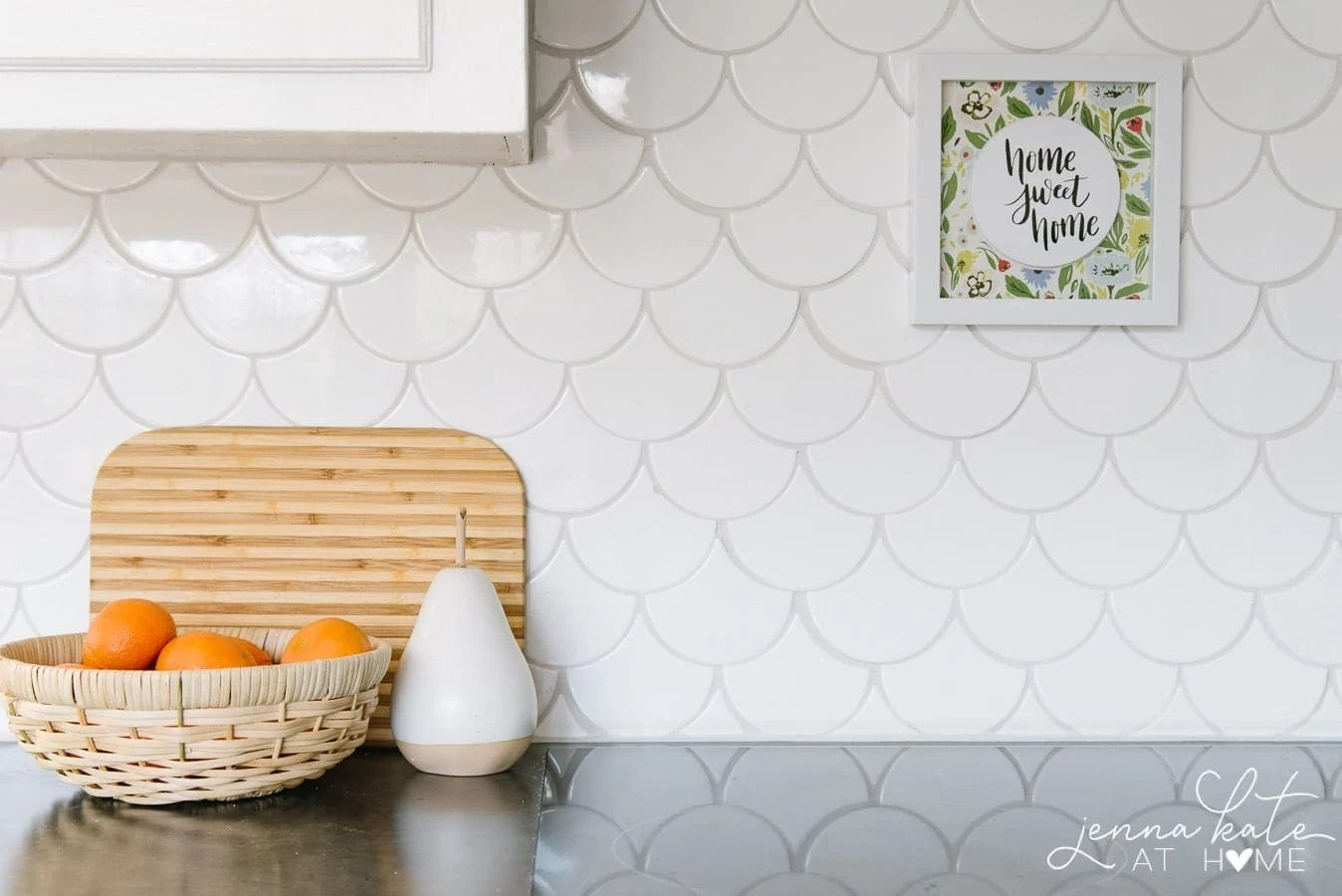 white scalloped backsplash tile