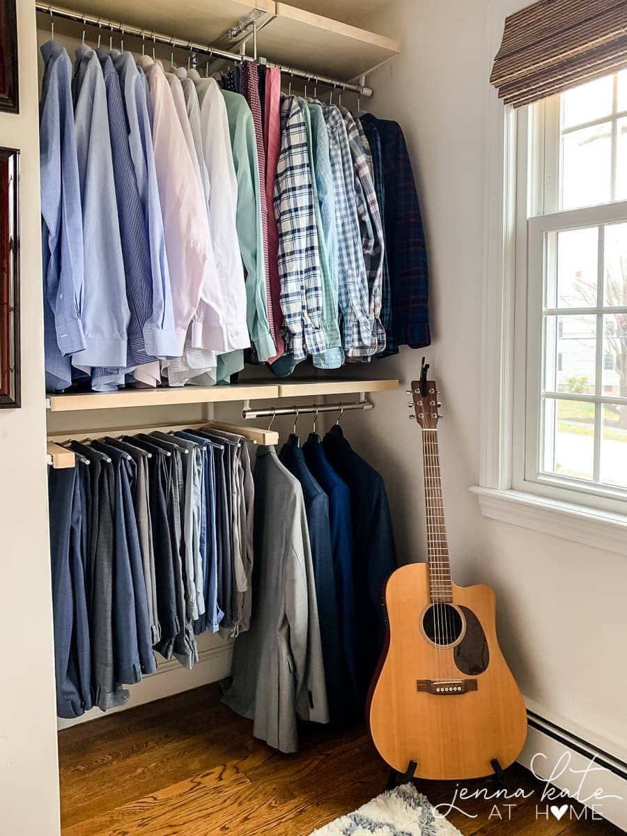 Organized closet system with men's clothing