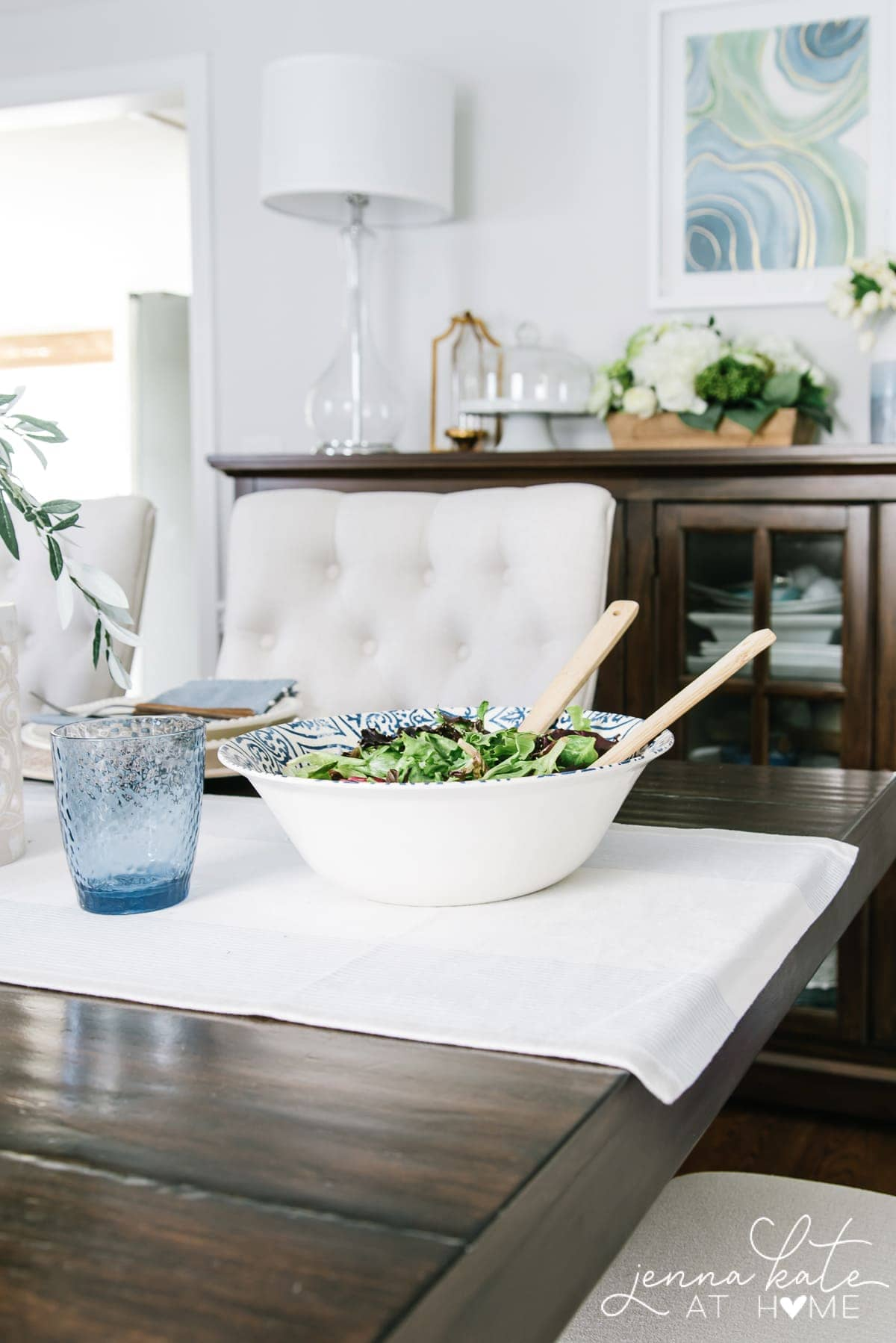 A simple coastal table setting that's perfect for summer with blue and white color scheme