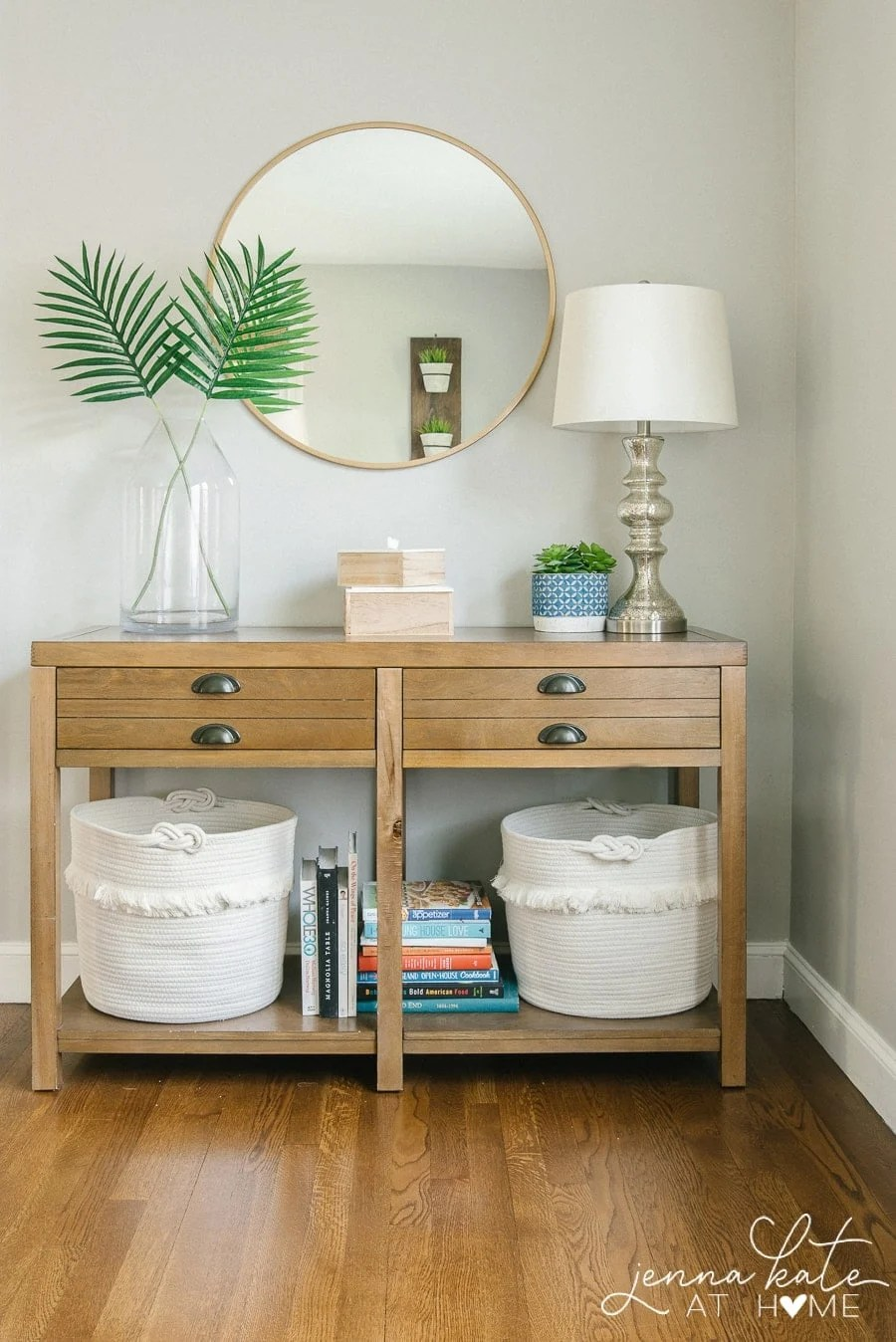 living room console table with toy storage baskets underneath is a great way to organize a small space
