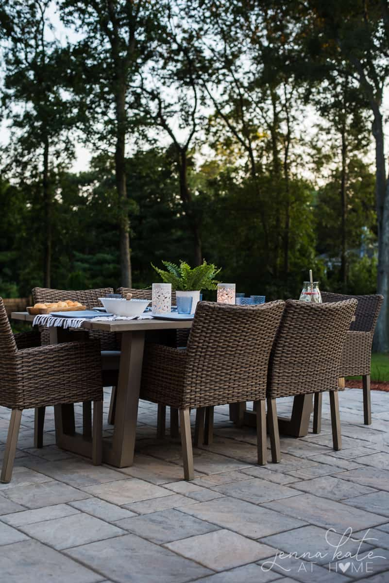 Our backyard patio dining table is adorned with glowing lanterns