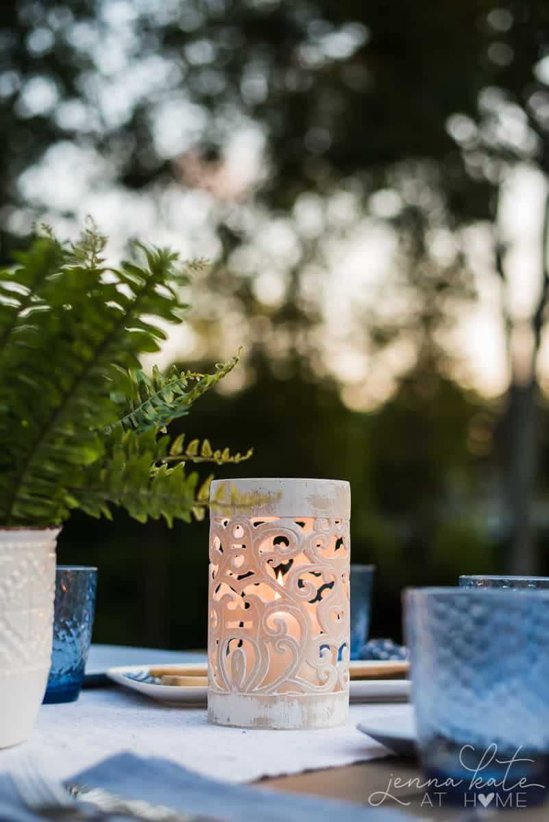 These coastal style candle lanters give our backyard patio dining table a warm, soft glow
