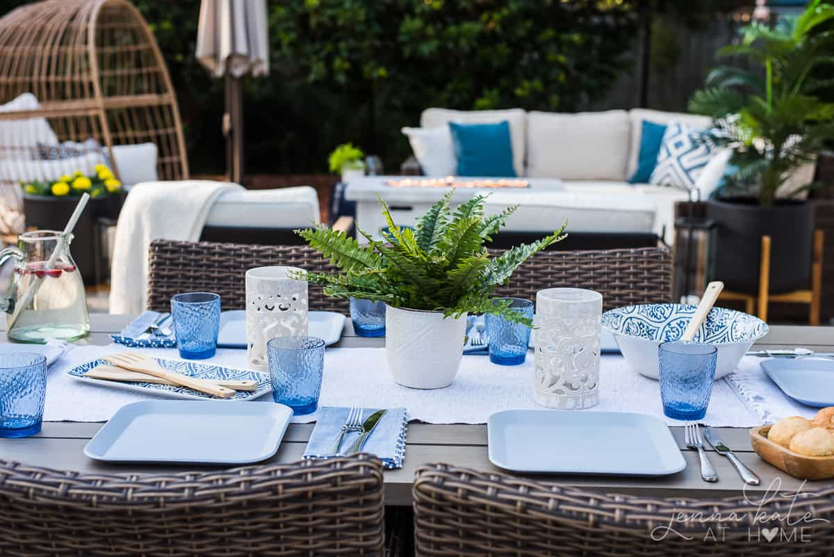 Blue and white drinkware and table settings give this outdoor patio table the coastal inspired look we were going for