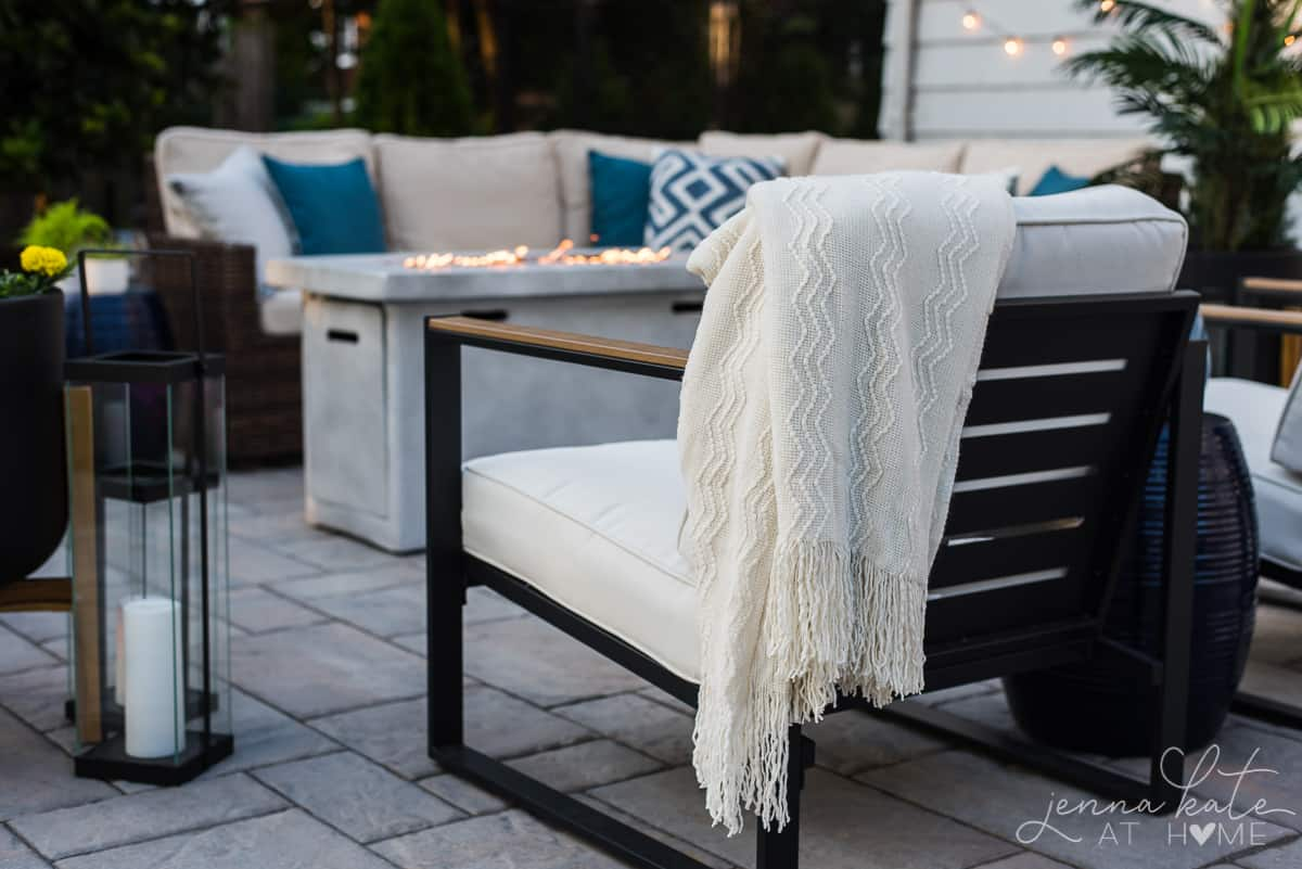 Ourdoor patio furniture with coastal colors and linens make a comfortable seating area