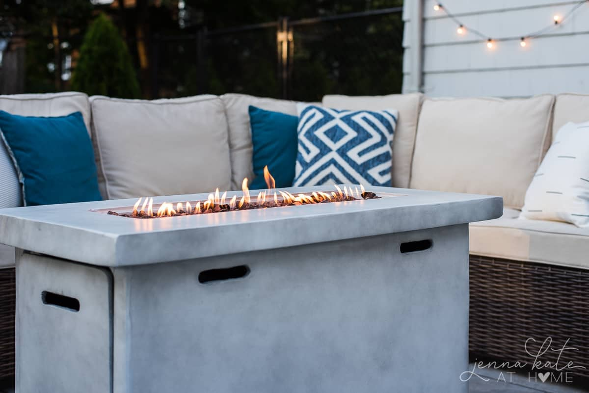 Our outdoor patio firepit warms up our coastal seating area