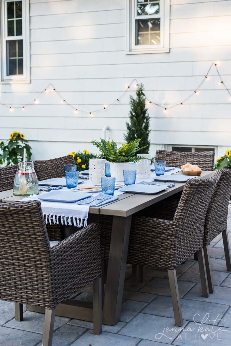Our outdoor patio dining area decorated with white and blue coastal style place settings
