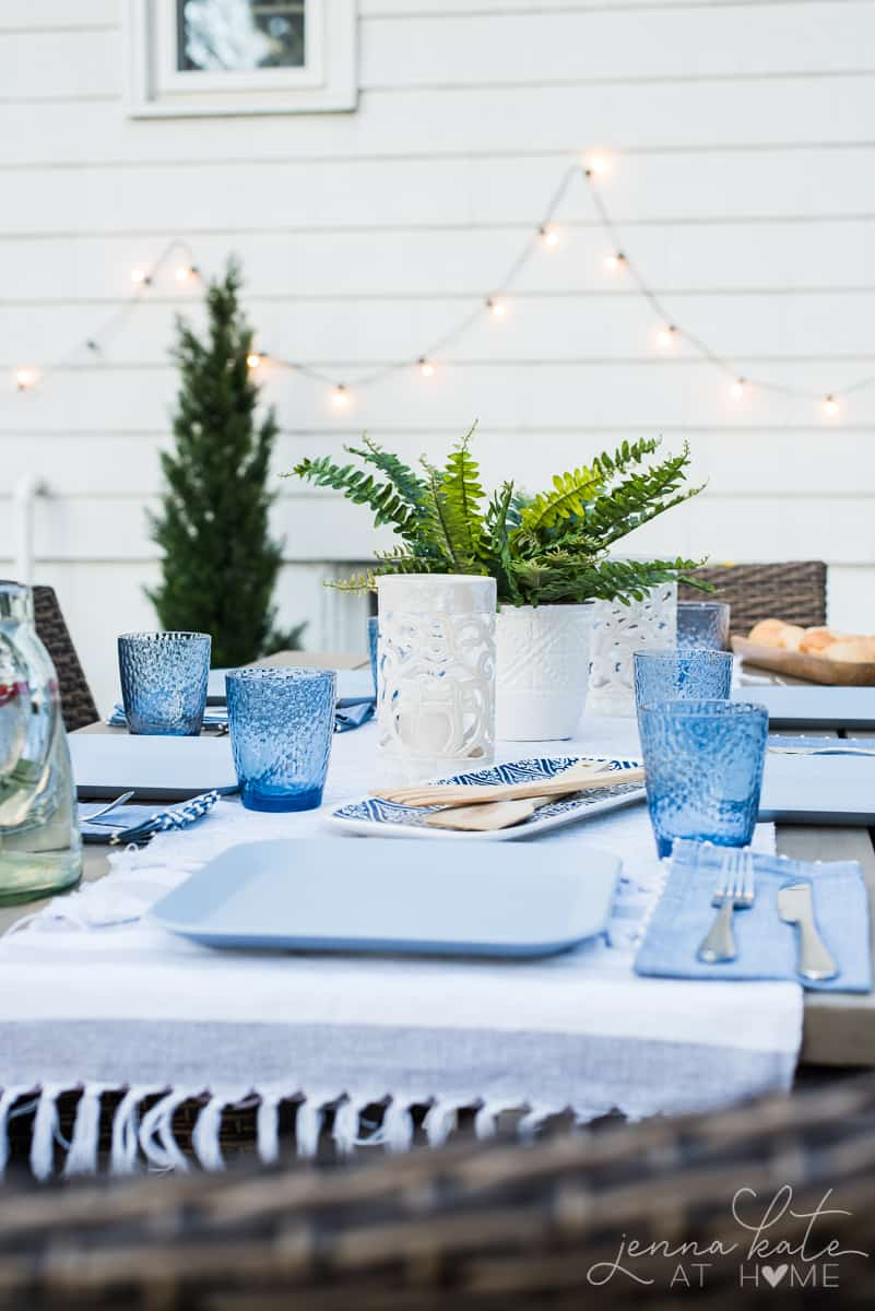Modern coastal inspired table settings make our outdoor patio dining table a welcoming and colorful spot to gather