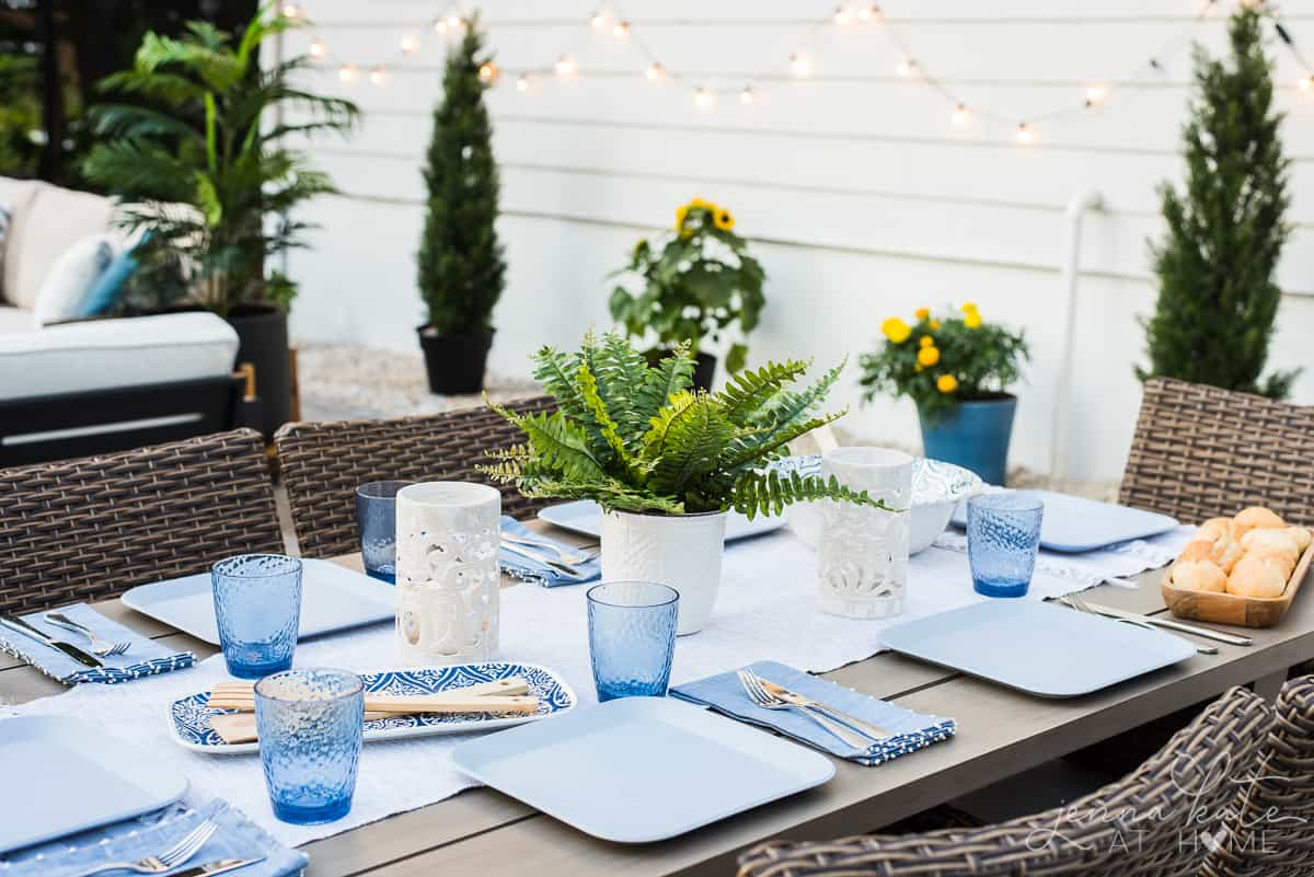 Our new Patio's dining area is decorated with blue and white coastal inspired place settings