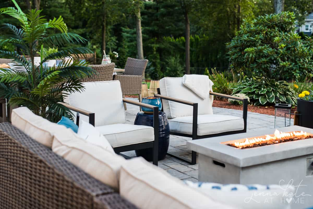 A warm and inviting seating area on our backyard patio has plentyyof room for friends and family to gather