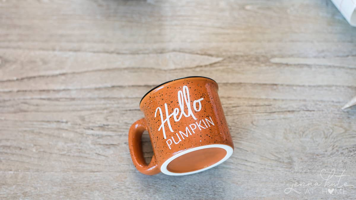 Orange ceramic mug with the words