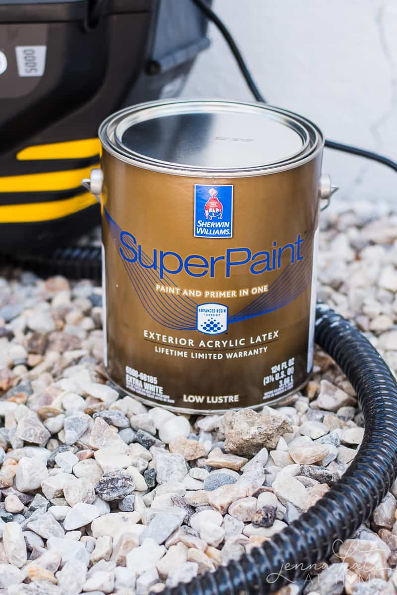 I used Sherwin Williams Superpaint exterior acrylic latex paint in extra white to paint the foundation of our house