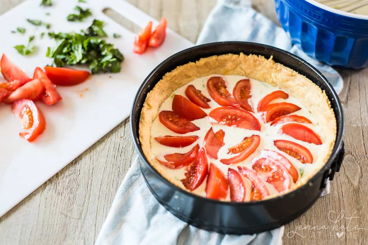 This tomato pie is a homemade pie crust filled with a creamy parmesan buttermilk custard and juicy, ripe tomato slices