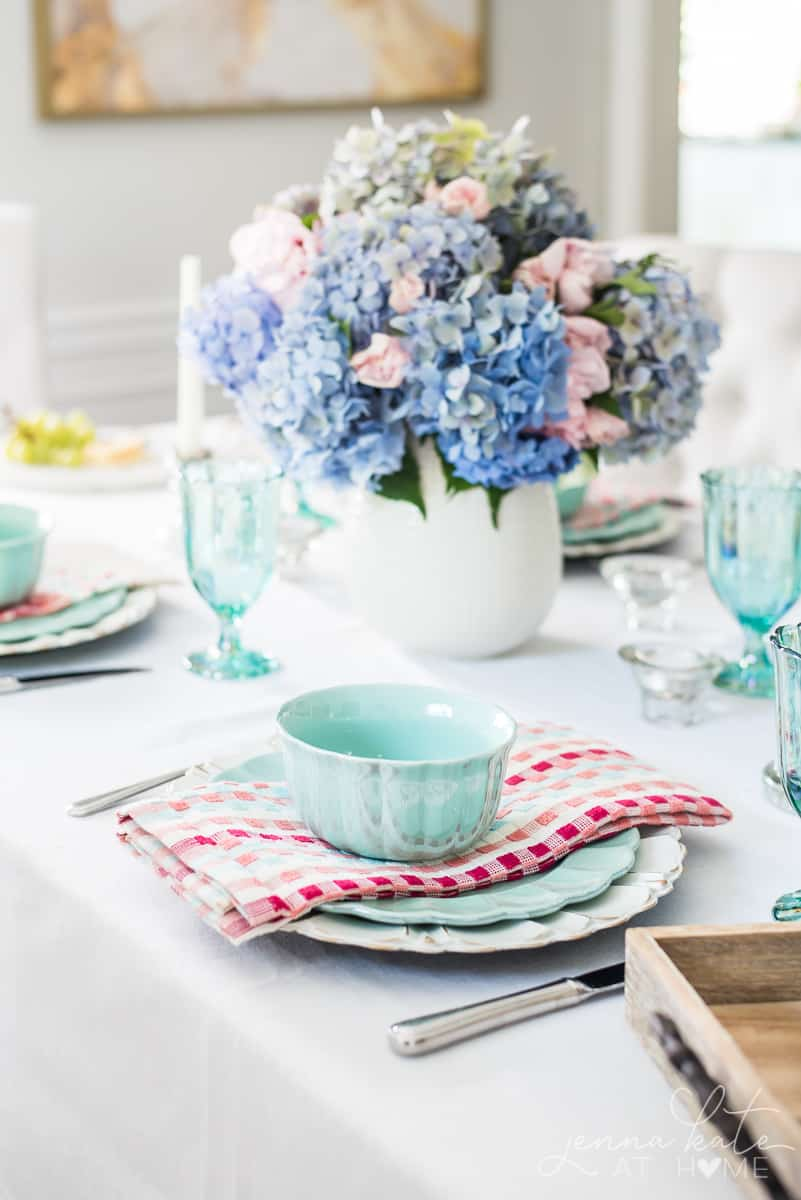This Spring tablescape combines bright pastels with florals for a fresh country chic style