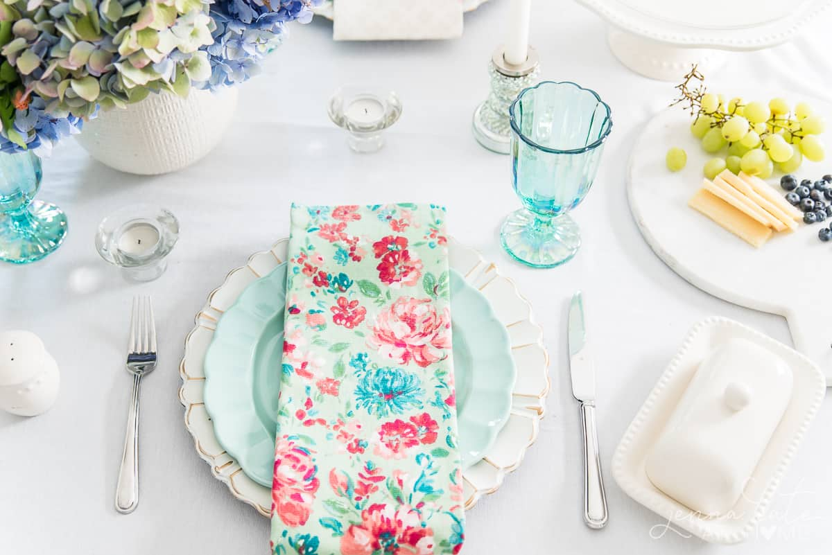 I love this affordable French country chic dishware! The floral napkins match perfectly with the seafoam green dishware
