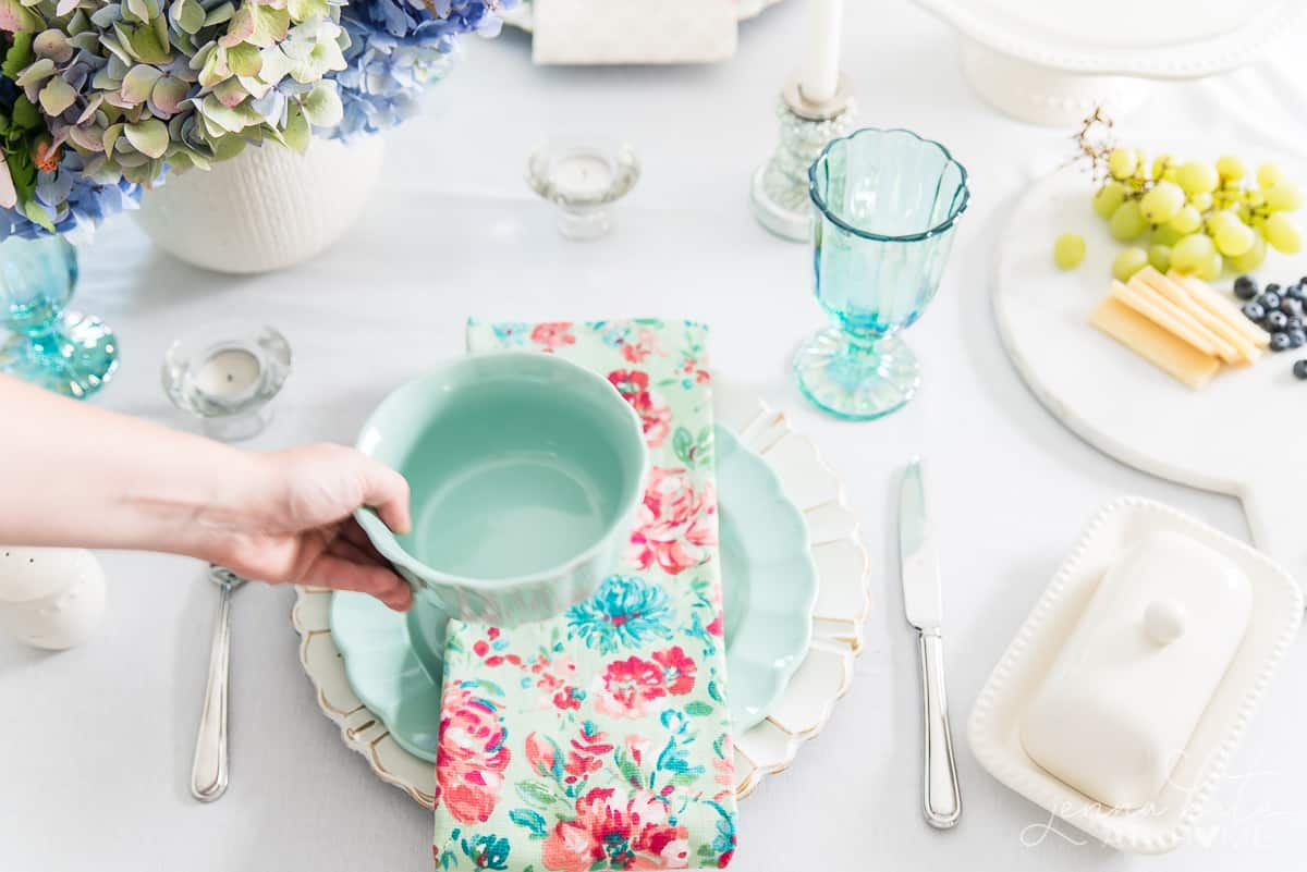 The pastel color pallet in this Spring tablescape is inspired by French country chic design