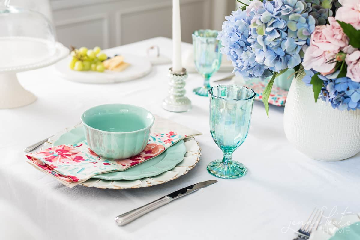 Seafoam green dishes and floral napkins give this tablescape a Spring touch