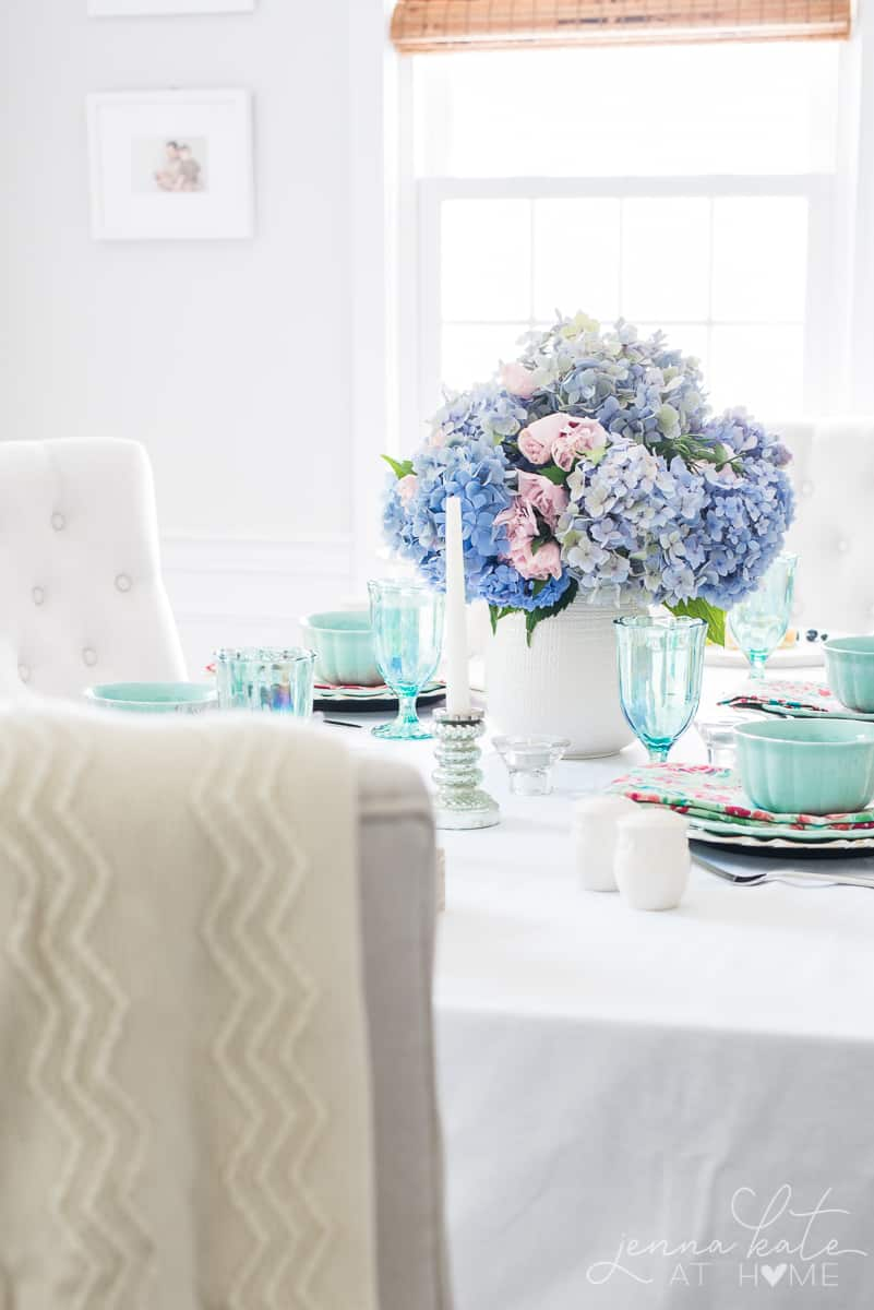 This Spring tablescape is inspired by French country chic style with pastel blues, greens, and pinks