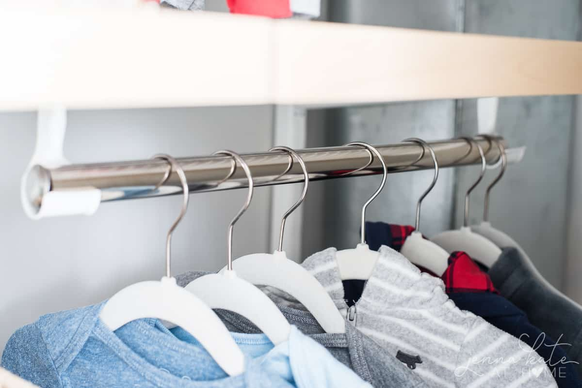 Double hung closet bars are a great way to organize a cluttered nursery closet