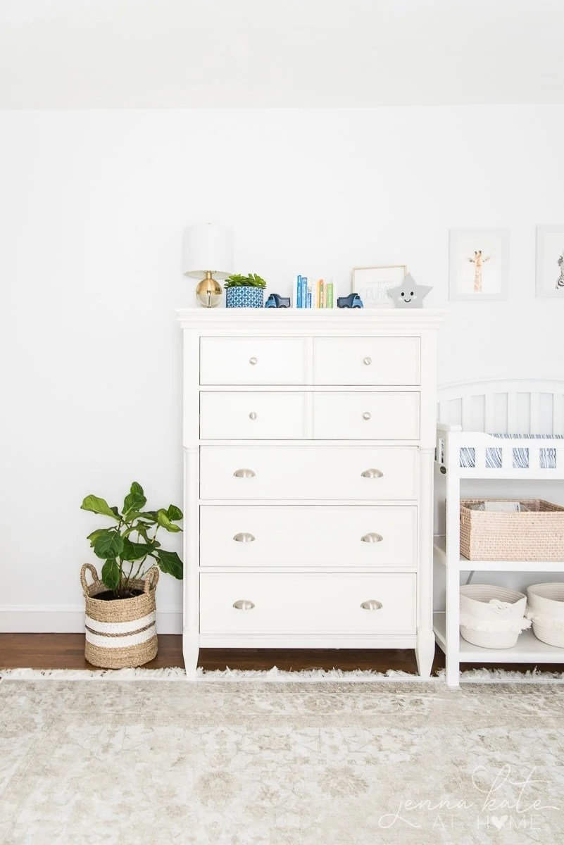 Nursery painted bright white is a great light reflecting color for dark rooms
