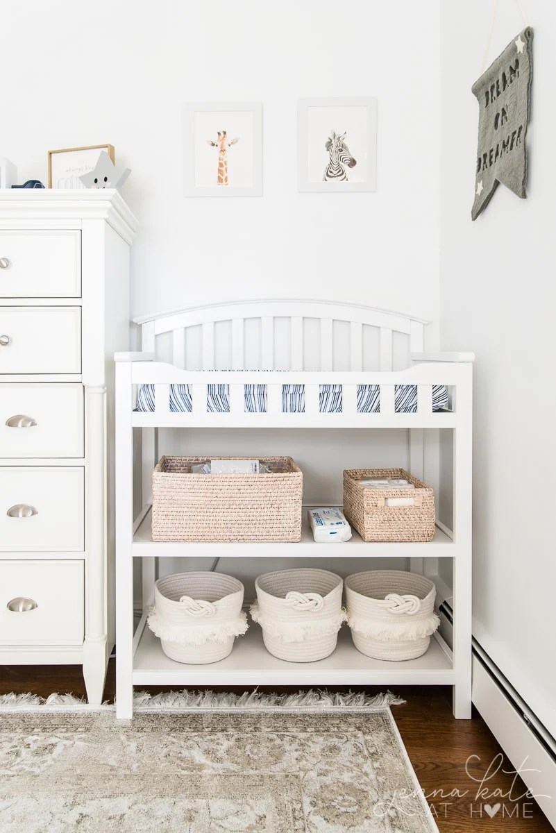 Changing table with baskets for organization