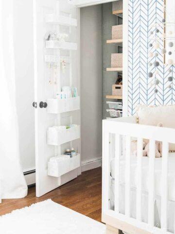 Organized nursery closet with storage behind the door