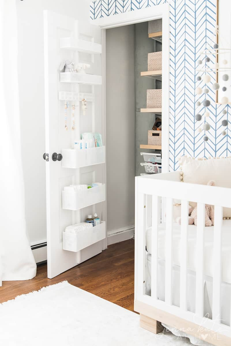 Closet door storage saves space and gives much needed extra storage in our nursery closet
