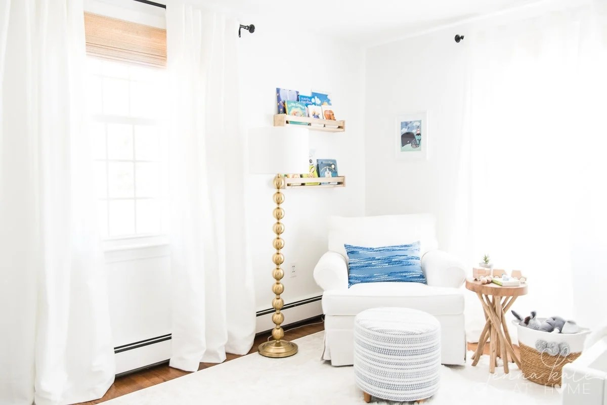Nursery with white walls and white glider