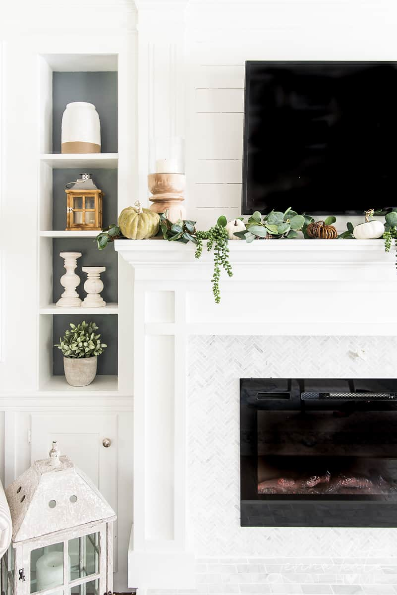 Left side of the mantel with a candle holder and garland