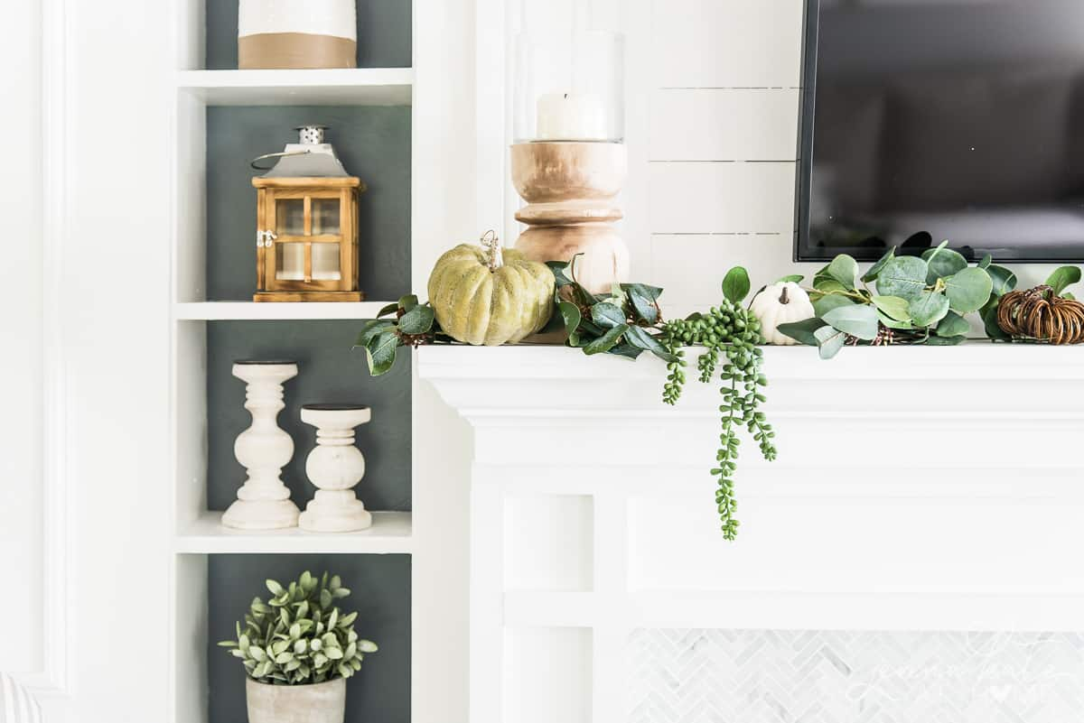 mantel with TV over with and fall decorations