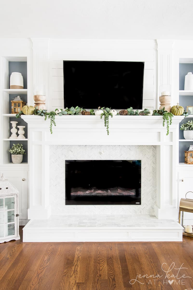 diy fireplace surround and mantel painted white with fall decor