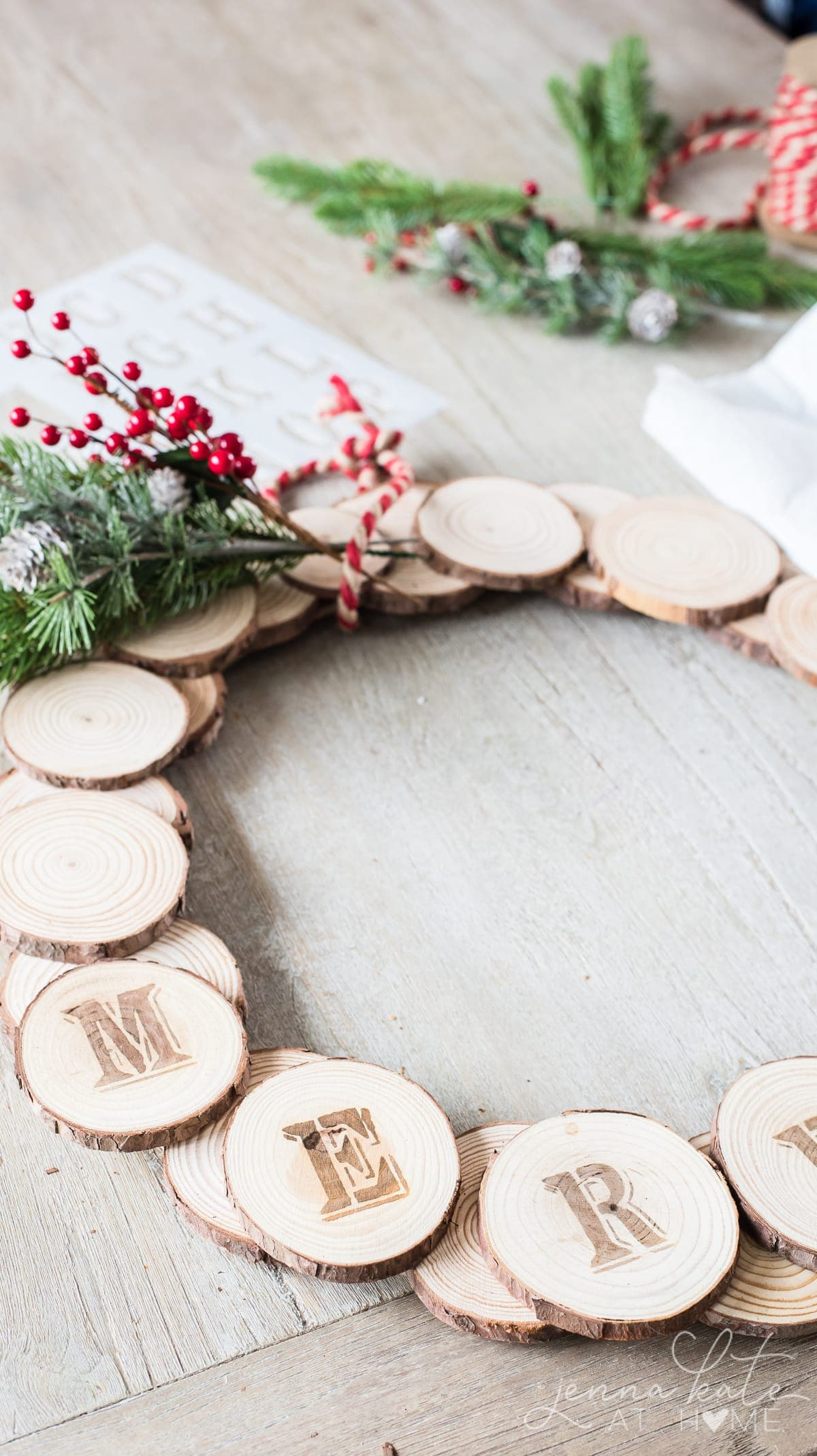 Faux berries attached to the wreath