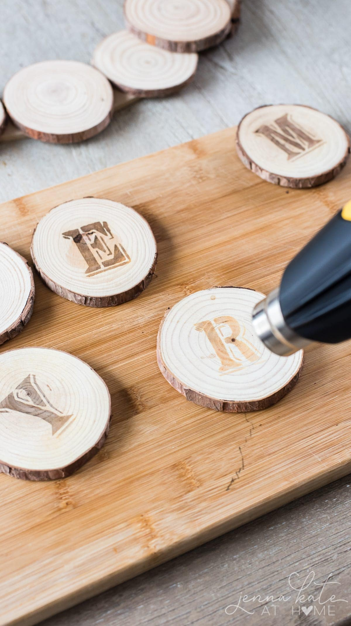 Using the heat gun to burn the stencil imprint into the wood
