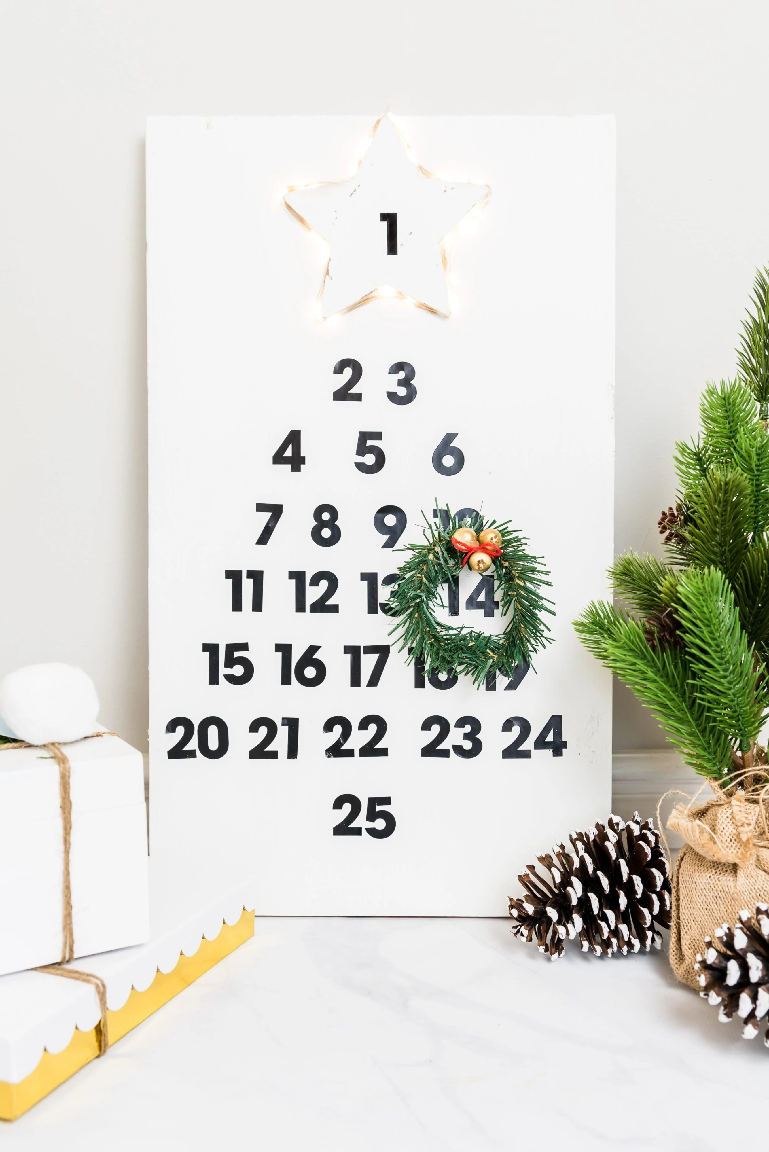This easy DIY wooden advent calendar is such a simple project, even the kids can help