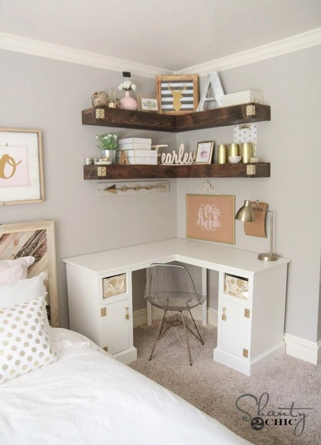 Corner shelves in a bedroom office define the space