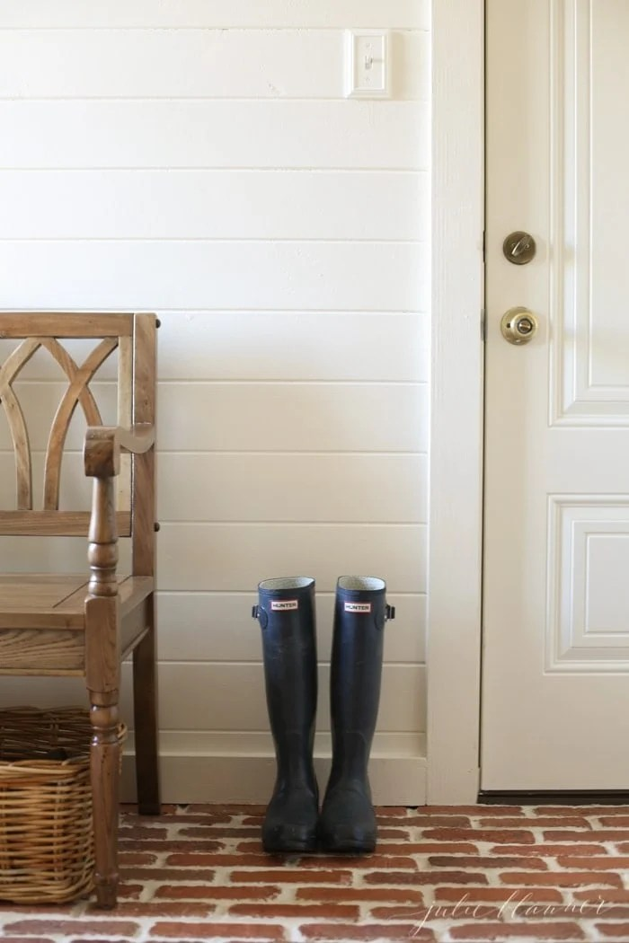 Mudroom painted Navajo White is perfect for a light light space