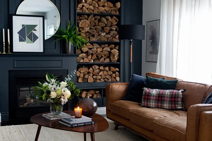 Dark and moody living room with cognac leather couch