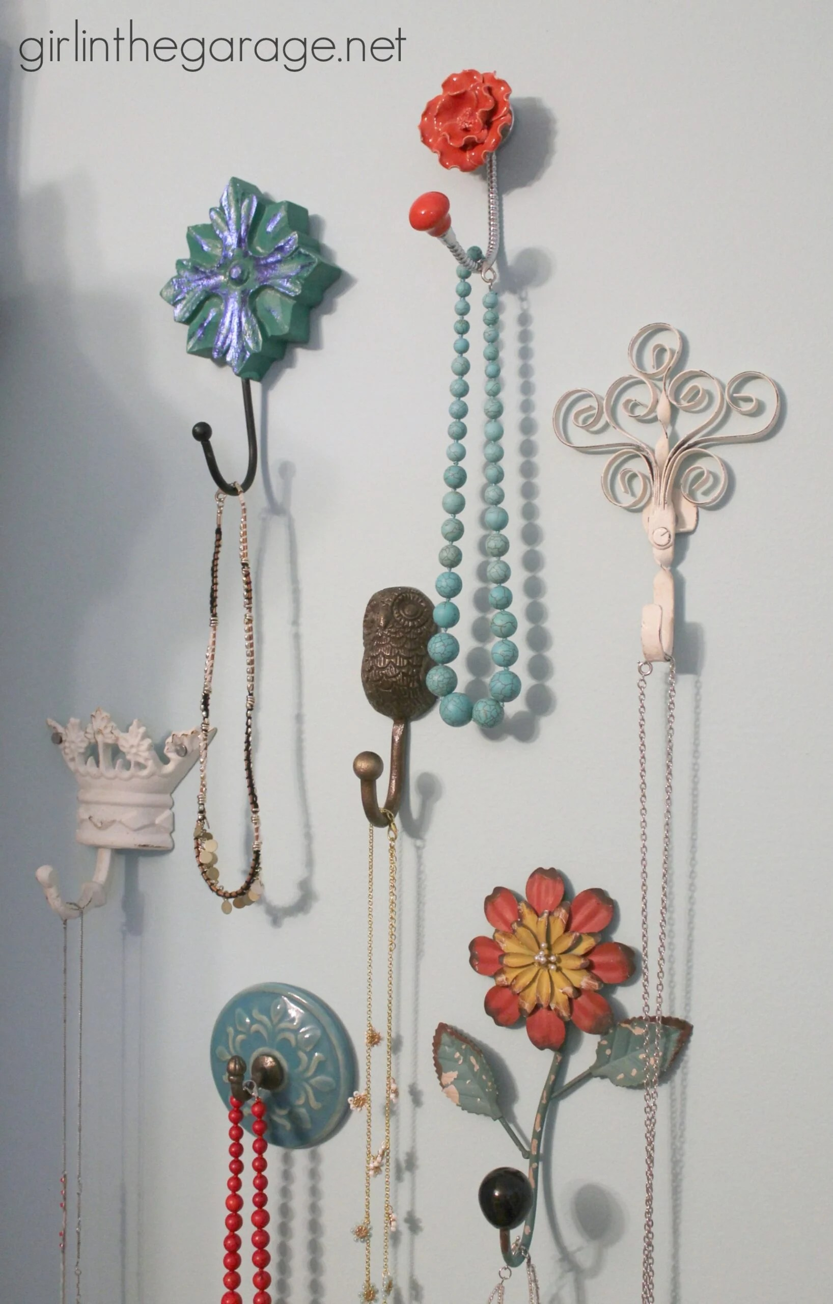 Various hooks used to hang jewelry on a wall