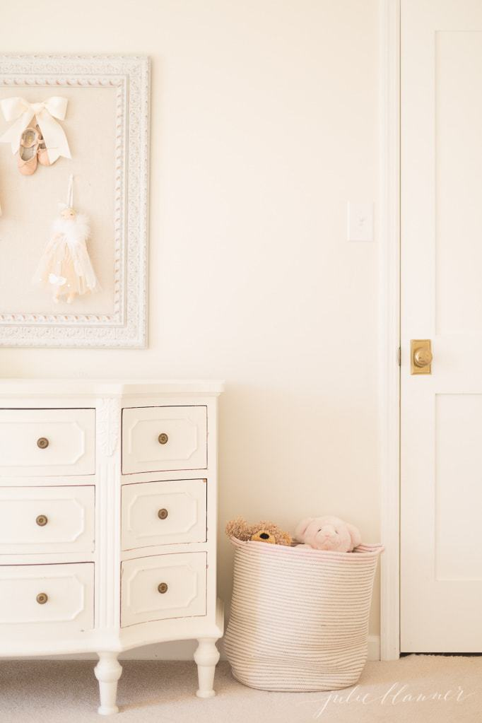 Warm and bright bedroom painted a creamy paint color