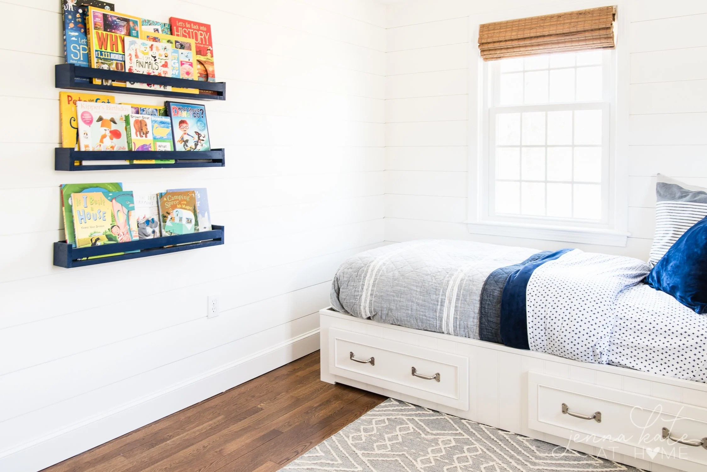Pottery Barn Kids Belden Bed with shiplap walls, bamboo shades, book ledges on the wall and patterned boy bedding. Perfect for a shared boy bedroom.