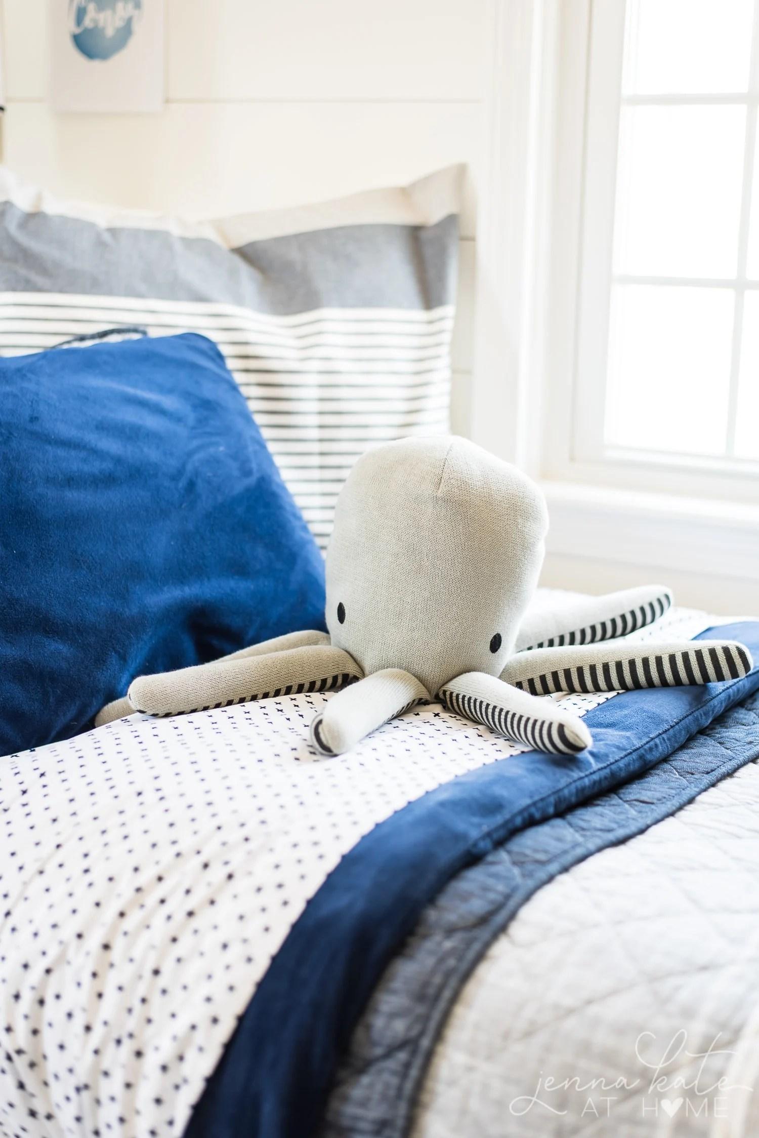 Toy octopus on bed. Fun boy bedroom decor ideas.