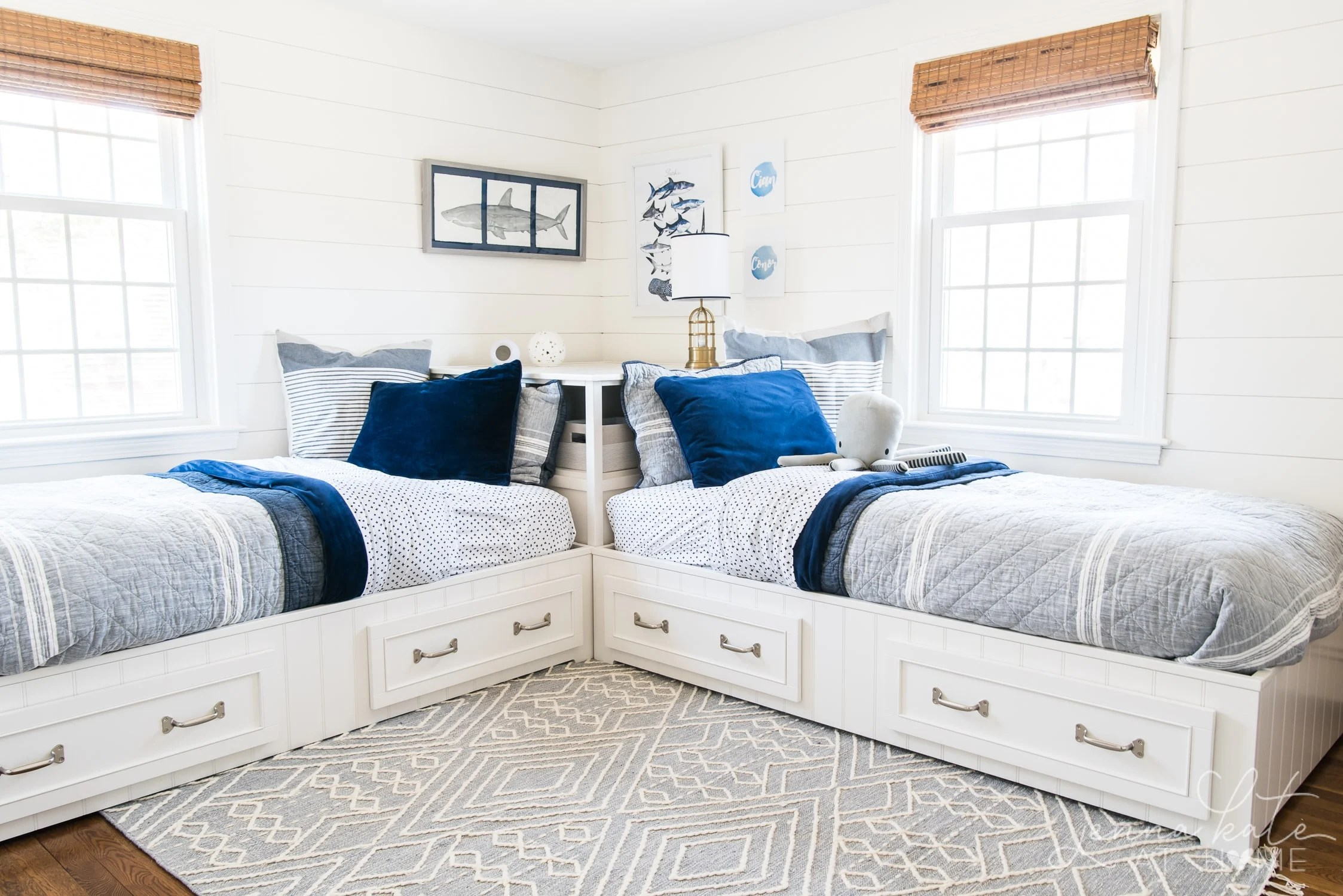 Kid boy bedroom design - coastal style bedroom set and navy and grey bedding with a shark theme
