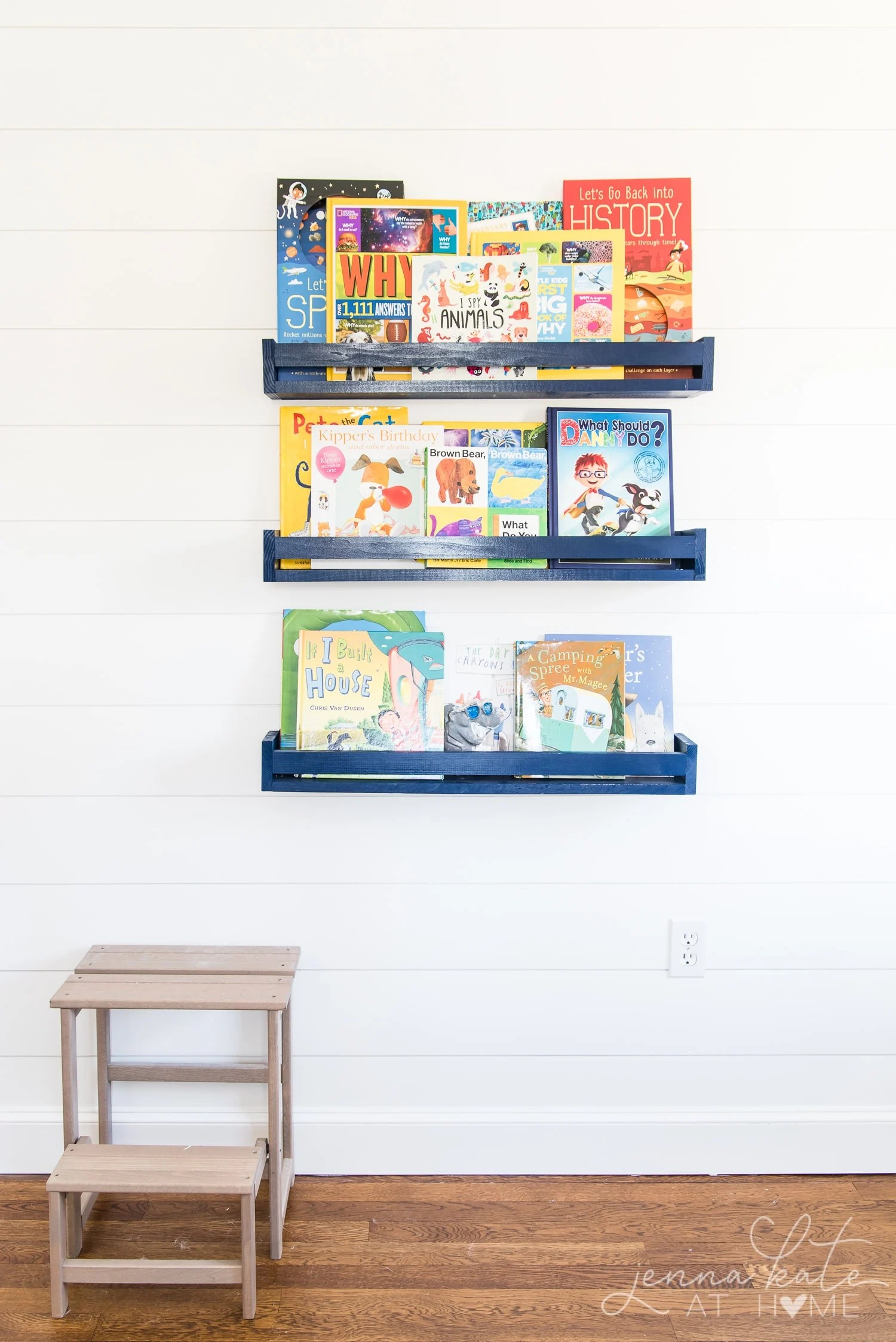 Book ledges on the wall of a kids bedroom instead of a bookshelf that takes up space in a small room