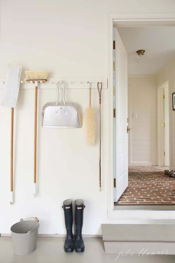 garage peg rail for brooms and mops