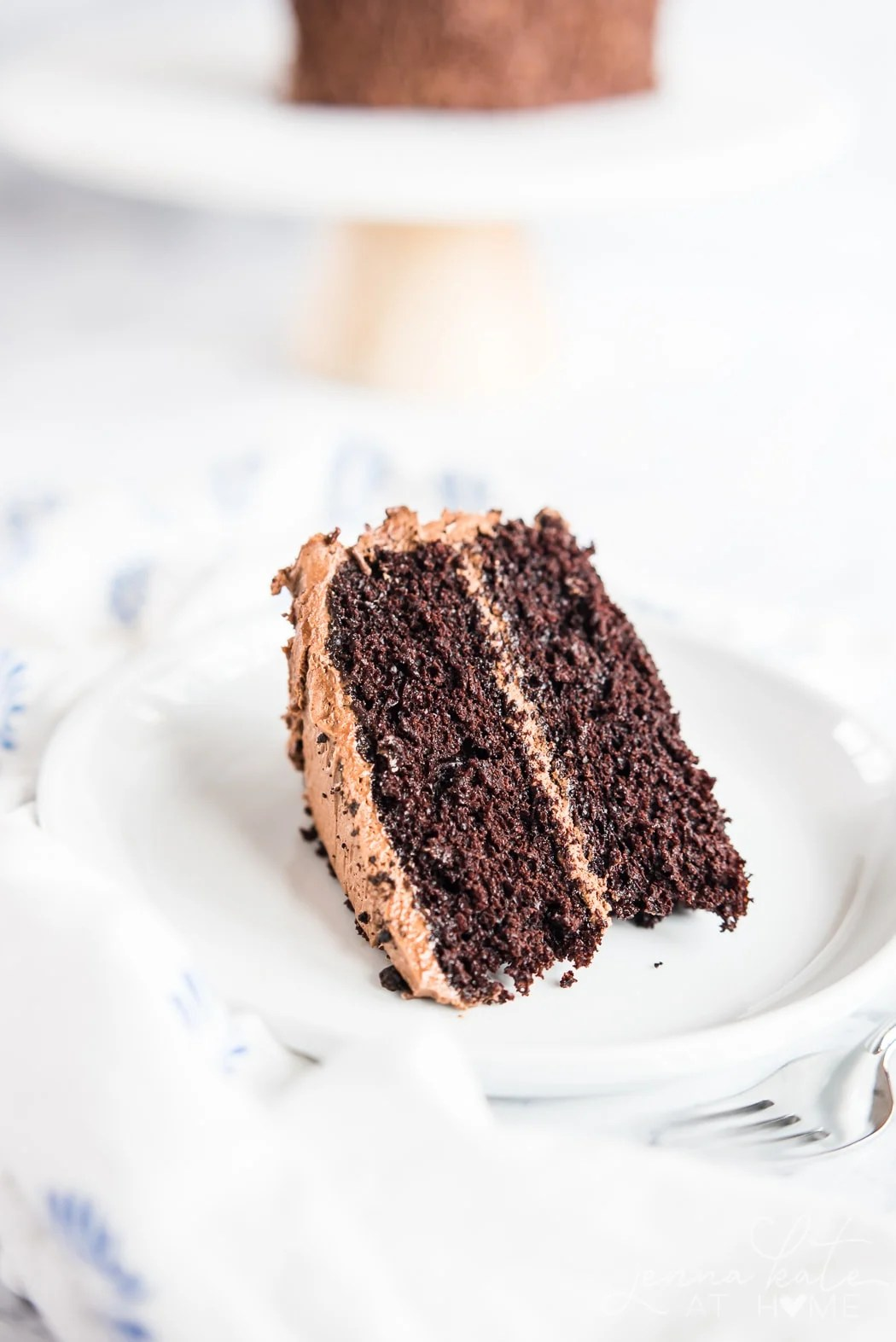 Slice of homemade chocolate cake with buttercream frosting