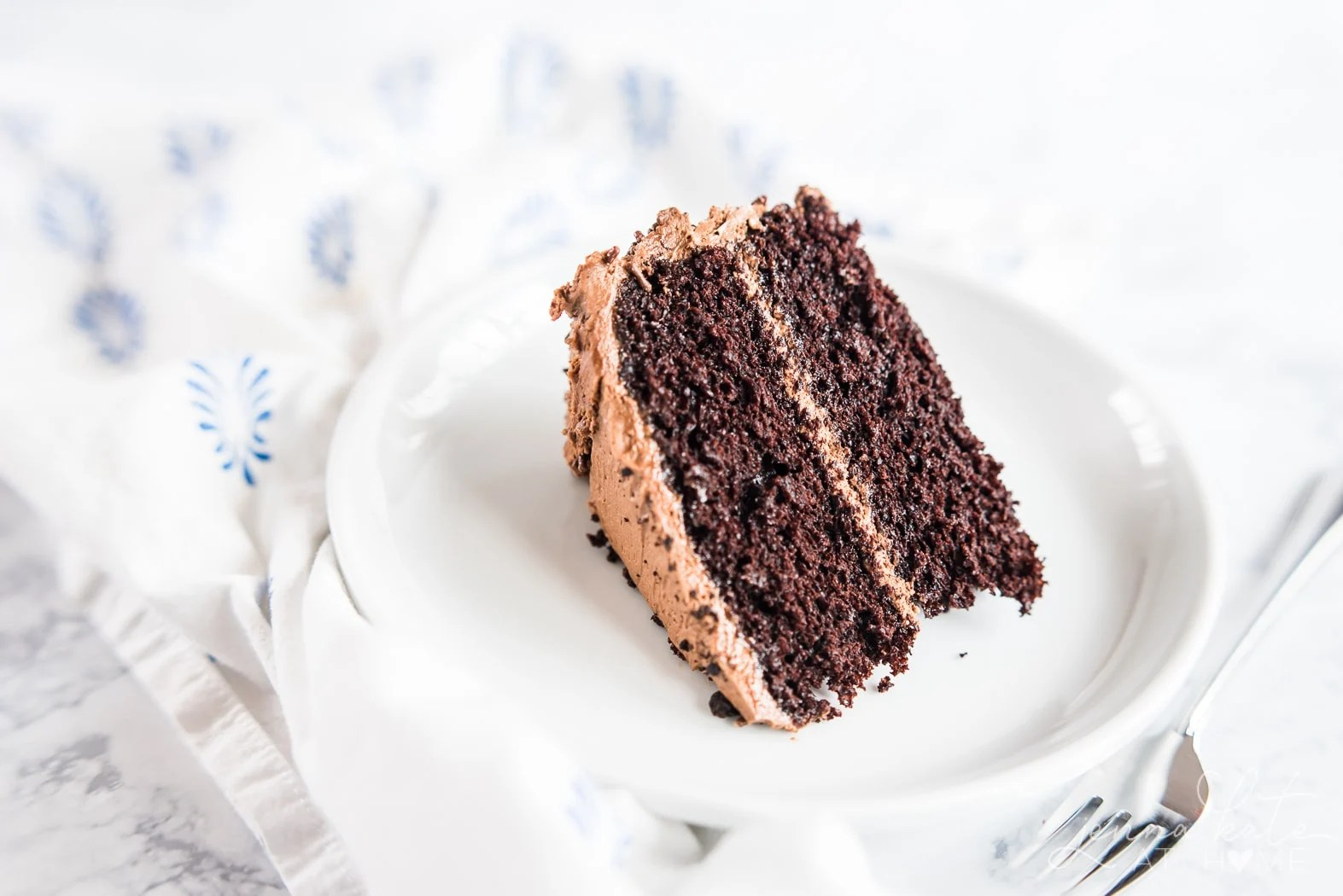 Easy chocolate birthday cake recipe, slice of moist cake on a plate