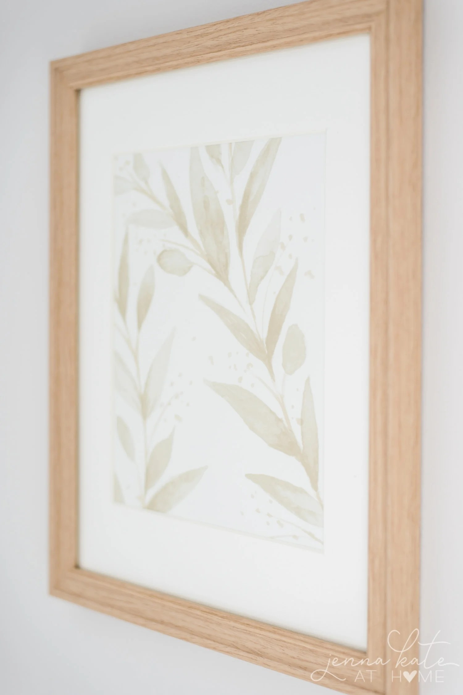Close up shot of the pretty floral detail wallpaper in a frame